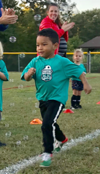 little boy participating in running race