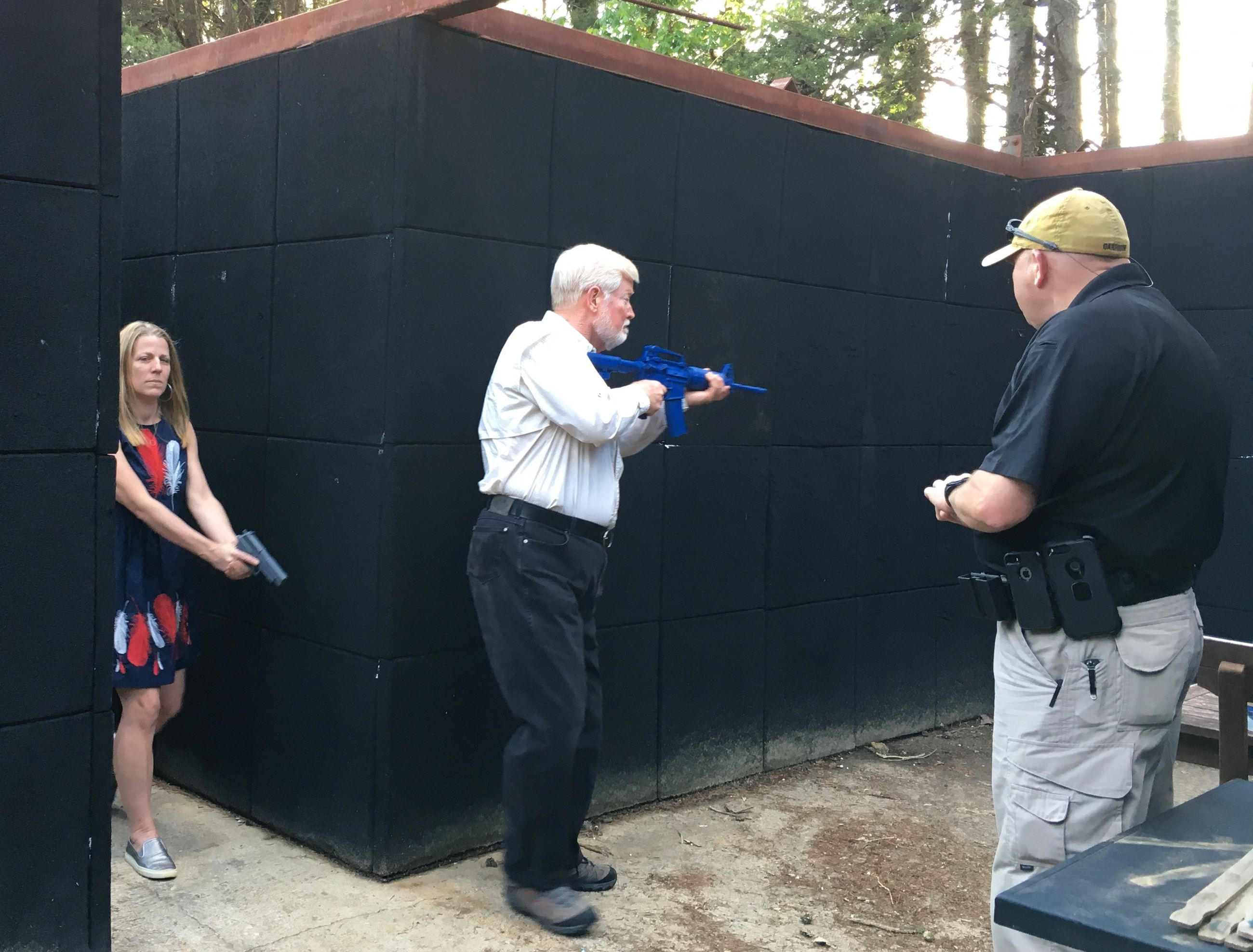 Citizens learn building clearing tactics in class with certified firearms instructors.