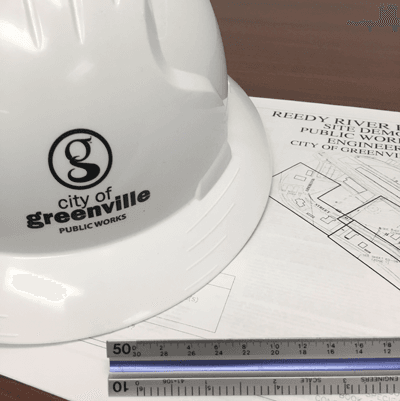 photo of a hard hat lying on site plans