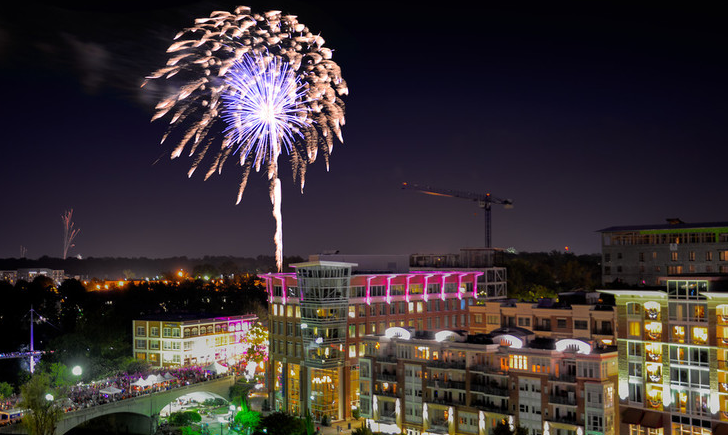 fireworks exploding over downtown Greenville