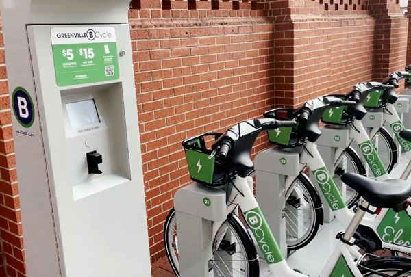 photo of a bikeshare rack filled with electric bicycles