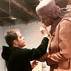 sculptor working on statue