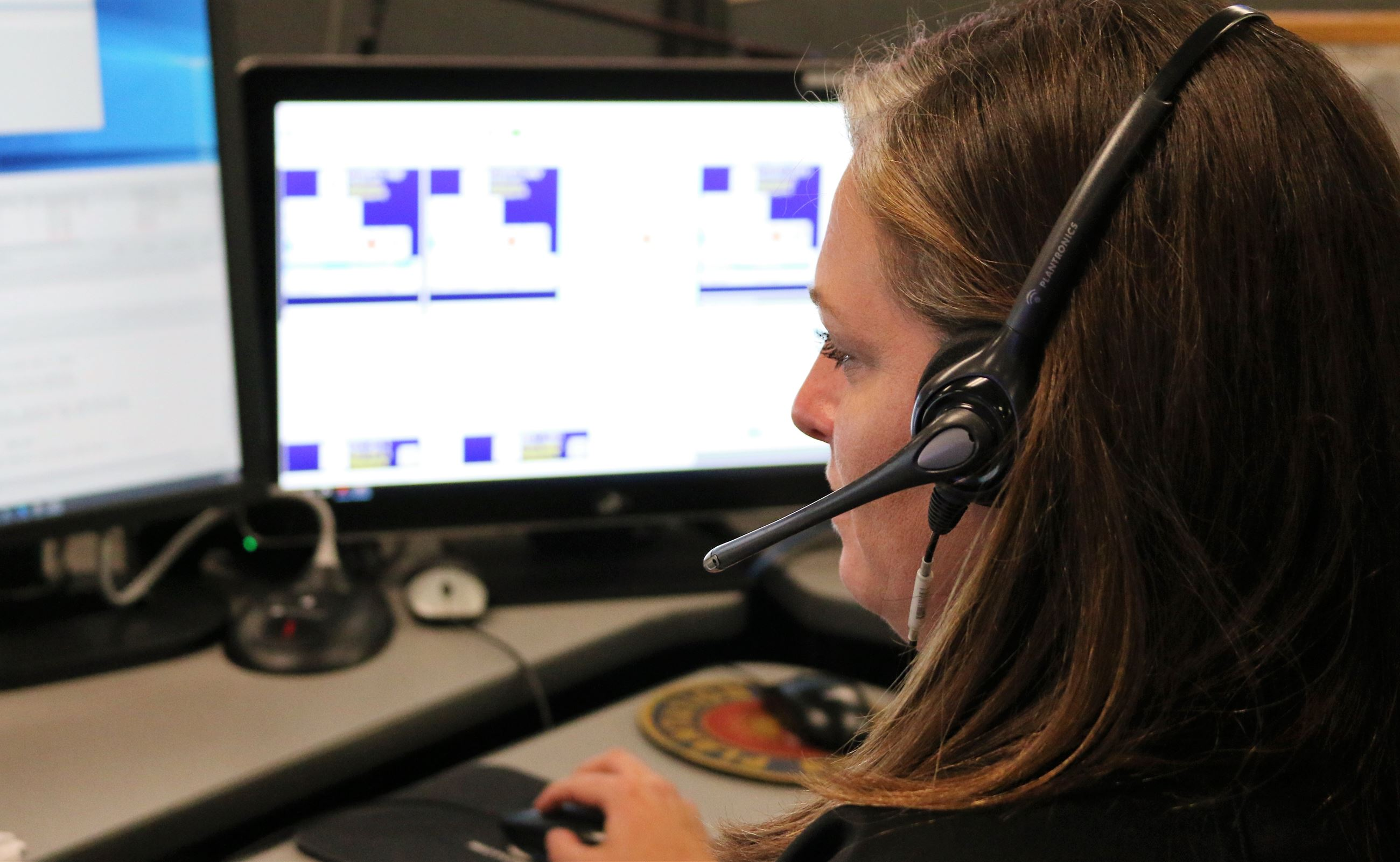 Dispatcher communicates with a caller.